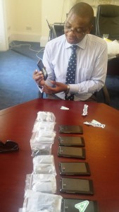 His Excellency Paramente Phamotse inspecting the smartphones at the Lesotho Embassy Dublin